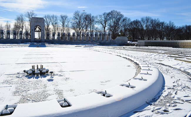 """WWII Memorial fountains covered in snow"" Photo by Frank Williamson"